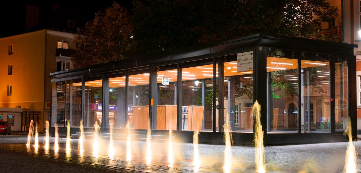 Modern, modular cafe with a black exterior and floor-to-ceiling Amberline windows