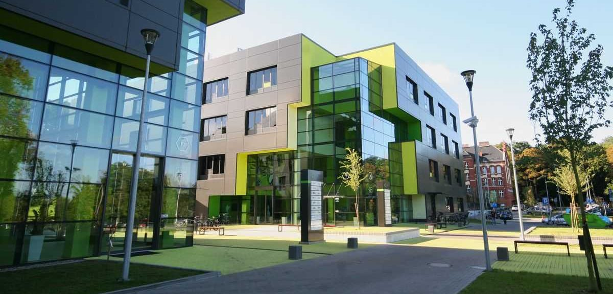 Modern, gray and green office building with Amberline windows