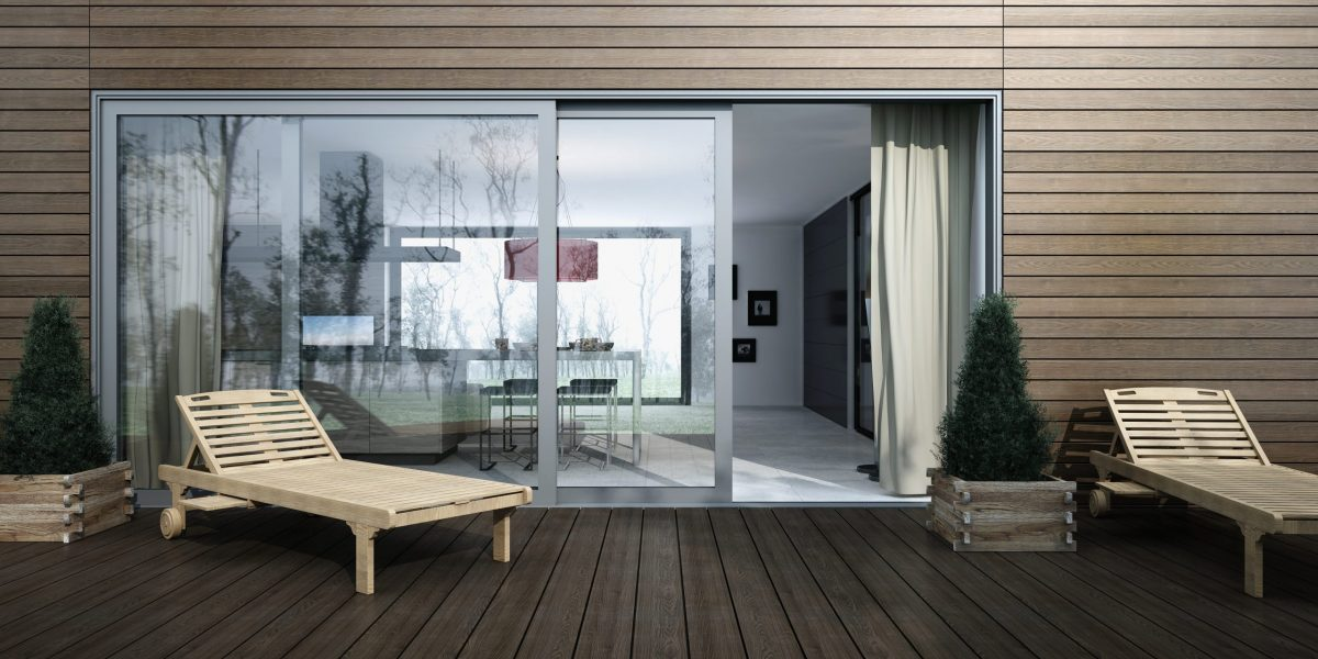 Residential patio with wood paneling and Amberline sliding doors.